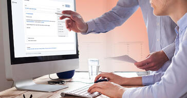 Man pointing at screen with Chaser automated credit control software