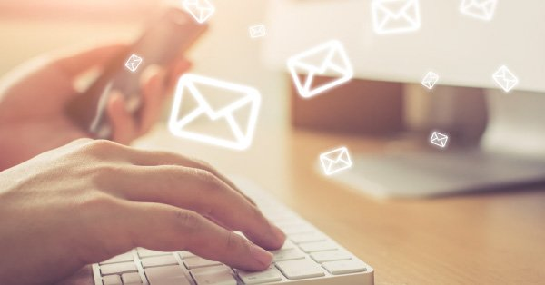 The 4 most effective email templates to get your invoices paid - typing on keyboard image of letters - chaser